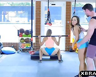Gym chicks with stacked bodies three-some with a coach