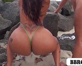 Miss raquel and spicy j showing of their large butts on the beach