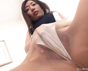 Asian minx in high heels and pantyhose masturbates on a chair