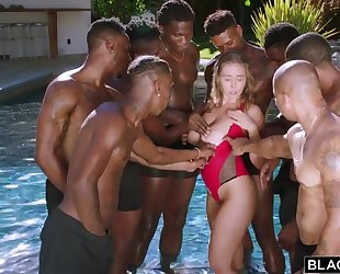 Insatiable nympho with big natural tits enjoys interracial gangbang