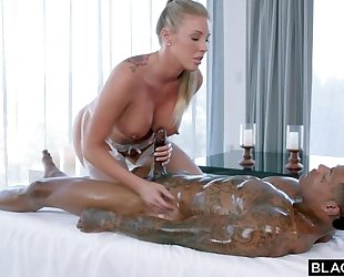 Busty fuckdoll in white stockings serves BBC in bed
