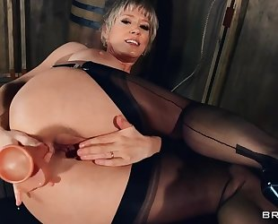 Mature lady in stockings and high heels fucks herself with various sex toys